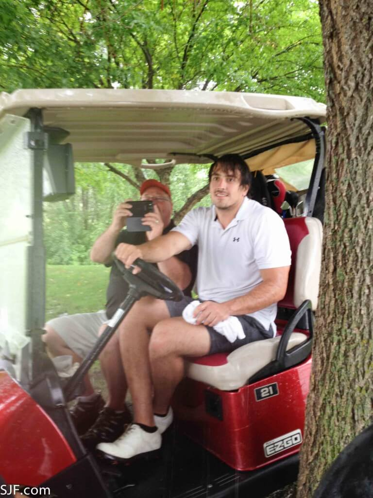 Sam and Vance golfing for charity