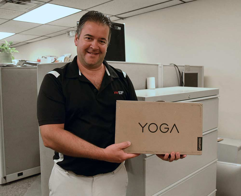 Ed Salonek takes home the grand prize of a Yoga Lenovo laptop