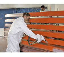 Painting Renewed Beams Going in the Paint Booth